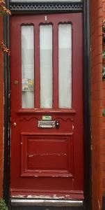Burgundy door before being painted