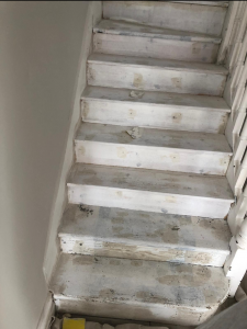 Photo of stairs projects before being painted