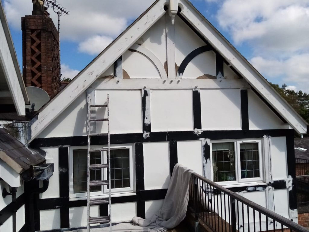 Our painters and decorators painting Tudor house front.